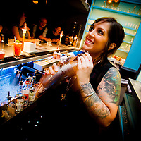 ORLANDO, FL -- Bartender Sheena Cuccia mixes a whiskey drink at The Pharmacy in Orlando, Florida.  (PHOTO / Chip Litherland)