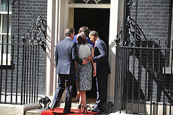 © licensed to London News Pictures. LONDON, UK  24/05/11. Barack Obama, and Michelle Obama are met by David Cameron and Samantha Cameron in Downing Street during President Obama's first State Visit to the United Kingdom. Please see special instructions. Photo credit should read Stephen Simpson/LNP