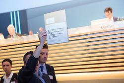 20.04.2016, Messe Essen, Essen, GER, Hauptversammlung RWE AG, im Bild Aktionaer will dem RWE-Vorstand eine Anzeige uebergeben, wird aber von Sicherheitskraeften fortgefuehrt // during the annual general meeting of RWE AG at the Messe Essen in Essen, Germany on 2016/04/20. EXPA Pictures © 2016, PhotoCredit: EXPA/ Eibner-Pressefoto/ Deutzmann<br /> <br /> *****ATTENTION - OUT of GER*****