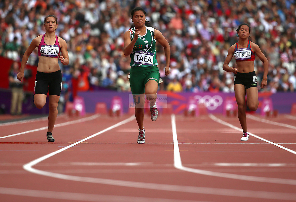 (L-R) Maysa Rejepova of Turkmenistan, Patricia Taea of the Cook Islands and Pauline Kwalea of Solomon Islands race in a 100m heat during the track and field events at the Olympic Stadium during day 6 of the London Olympic Games in London, England, United Kingdom on August 3, 2012..(Jed Jacobsohn/for The New York Times)..