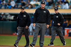 OAKLAND, CA - SEPTEMBER 09:  MLB umpires Lance Barksdale #23, Will Little #93 and Ted Barrett #65 enter the field before the game between the Oakland Athletics and the Seattle Mariners at the Oakland Coliseum on September 9, 2016 in Oakland, California. The Seattle Mariners defeated the Oakland Athletics 3-2. (Photo by Jason O. Watson/Getty Images) *** Local Caption *** Lance Barksdale; Will Little; Ted Barrett