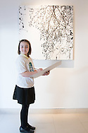 Nine year-old Ashley Hubbard from Charlton Manor Primary School draws Sue Arrowsmith's acrylic on canvas  &quot;When The Lights Are Low&quot;, 2012, at the preview for the It&rsquo;s Our World charity auction at Christie's, Mayfair, London.<br /> Picture by Paul Davey/Focus Images Ltd +447966 016296<br /> 04/03/2016
