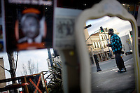 A man, reflected off a mirror, stands on the corner of Georgia and Marin streets, in downtown, in Vallejo, Ca., on Wednesday, Feb. 10, 2010. Recent crime wave has residents and businesses on edge.