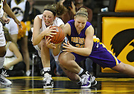 December 22 2010: Iowa center Morgan Johnson (12) and Northern Iowa center Lizzie Boeck (20) battle for a lose ball during the second half of an NCAA college basketball game at Carver-Hawkeye Arena in Iowa City, Iowa on December 22, 2010. Iowa defeated Northern Iowa 75-64.