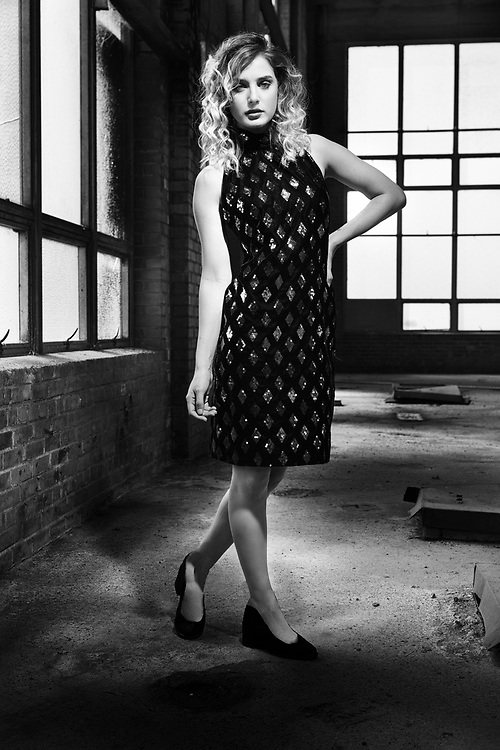 Model in 1980s vintage clothing and hair in abandoned factory. By Gerard Harrison fashion photographer,  Houston Texas