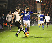 Fuham midfielder Jamie O'Hara tackling Ipswich midfielder Jonathan Douglas during the Sky Bet Championship match between Fulham and Ipswich Town at Craven Cottage, London, England on 15 December 2015. Photo by Matthew Redman.