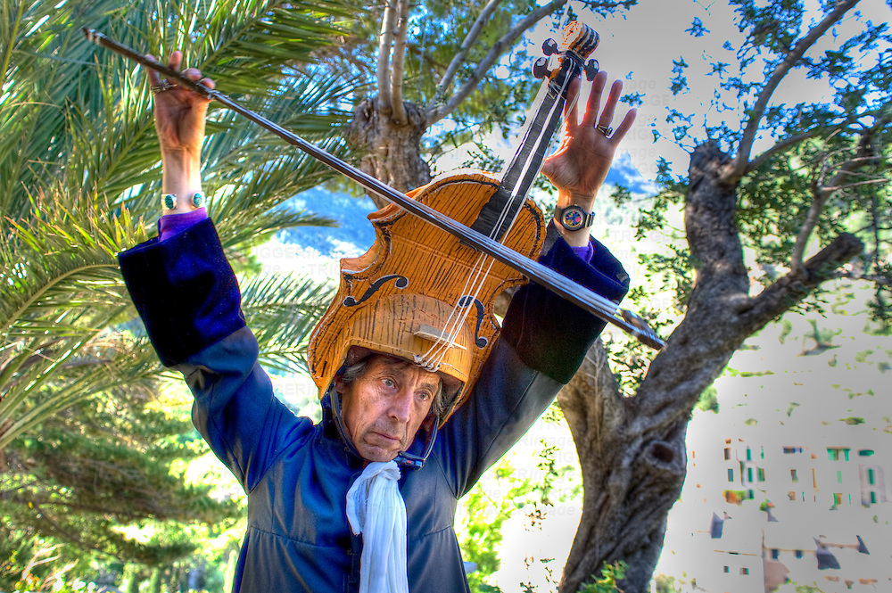 A performer wearing a violin hat
