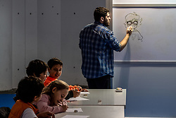 April 13, 2018 - Barcelona, Catalonia, Spain - A comic artist and drawing teacher is seen during a class for school children. The 36th Barcelona International Comic Fair from 12th-15th April 2018 in Fira Barcelona Montjuïc. (Credit Image: © Paco Freire/SOPA Images via ZUMA Wire)