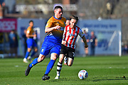 Matt Preston (4) of Mansfield Town is chased by Matt Jay (17) of Exeter City during the EFL Sky Bet League 2 match between Exeter City and Mansfield Town at St James' Park, Exeter, England on 30 March 2019.