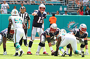 Sep 15, 2019; Miami Gardens, FL, USA;  New England Patriots quarterback Tom Brady (12) calls a play at the line of scrimmage during an NFL game against the Miami Dolphins at Hard Rock Stadium in Miami Gardens, FL. The Patriots beat the Dolphins 43-0. (Steve Jacobson/Image of Sport)