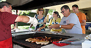 (from left) Frank Enscoe of Harrison Townsip; Victoria  Culler of Mansfield, Ohio; Ashley Ellis of Sidney; Dennis Culler of Mansfield and Brandon Ellis of Sidney during the Polish Summer Fest at the Polish Picnic Ground in Dayton, Sunday, July 31, 2011.  Enscoe says it's his forth or fifth year cooking at the Polish Club picnic, and found out that you don't wear a belt near the grill because the buckle conducts the heat of the fire.