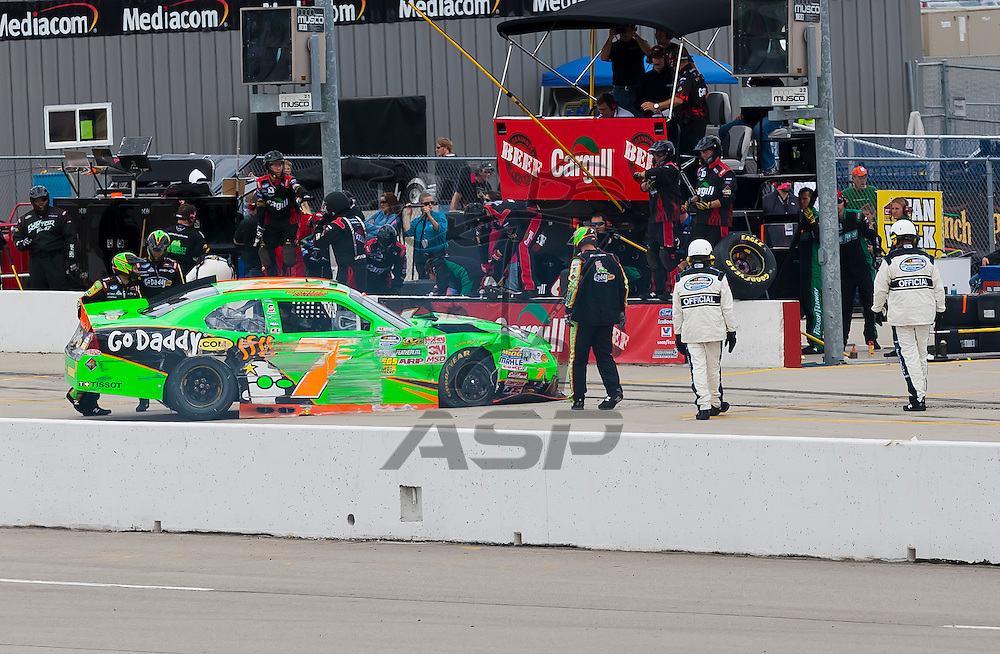 NEWTON, IA - MAY 20, 2012:  Danica Patrick (7) brings her car in for service during the Pioneer Hi-Bred 250 at the Iowa Speedway in Newton, IA.