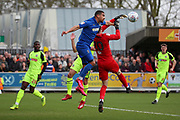 AFC Wimbledon striker Kweshi Appiah (9) battles for possession with Bolton Wanderers goalkeeper Remi Matthews (20) during the EFL Sky Bet League 1 match between AFC Wimbledon and Bolton Wanderers at the Cherry Red Records Stadium, Kingston, England on 7 March 2020.