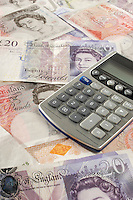 British paper currency and calculator
