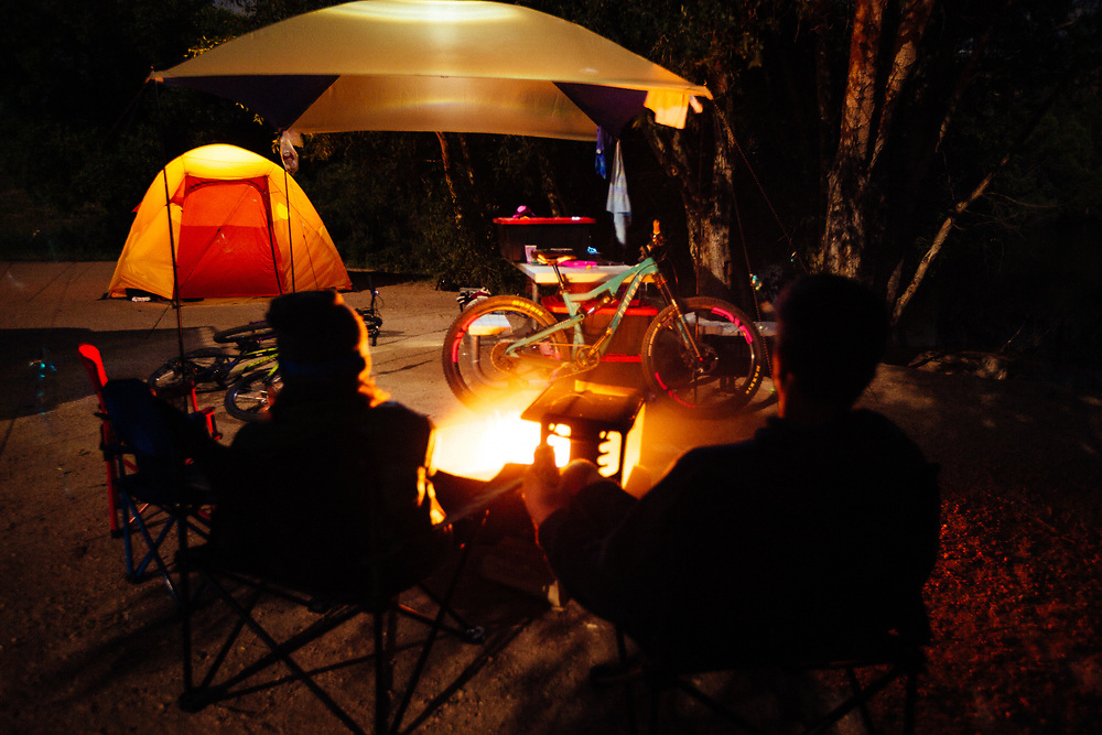 The Goodrich family (Jay, Heather, Jade, Micah) campsite after dark with a star filled Eastern Wyoming sky.