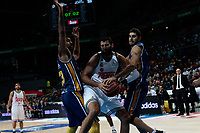 SPAIN, Madrid: Real Madrid's Greek player Ioannis Bourousis and Ucam Murcia´s Spanish player Jose Angel Antelo Paredes during the Liga Endesa Basket 2014/15 match between Real Madrid and Ucam Murcia, at Palacio de los Deportes in Madrid on November 16, 2014.