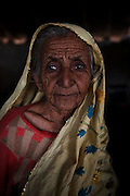 A portrait of Nazam Babar, age 85, who's whole family enslaved for 14 years for borrowing US$143. <br /> <br /> Following the release of the Global Slavery Index by the Walk Free Foundation Pakistan is ranked 3rd worse in the world behind India and China. The Asian Development Bank estimates some 1.8 million people are slaves in Pakistan yet other estimates reach up to 4 million people, most of which toil year after year in brick kilns or sugar cane plantations. Their stories are the same; they have no-where to turn so they borrow money from a land-owner for a medical emergency or marriage dowry. The landlords pay in return for work, their labour supposed to be taken off the amount borrowed. Yet after years of no salary incredibly their amount owed is often quadrupled, the excuse being the amount they cost to feed! Many are chained, abused, raped and even killed.<br /> <br /> For years they had no where to run, no one to help but now a small local NGO called the Green Development Rural Organisation (GDRO) works to free bonded-slaves by using the law against their captives. Yet, often freed slaves end up right back where they were or risk being hunted by the landowner and forced to return. So GRDO started building villages so slaves who escape or are freed have somewhere safe to go. It now has two, whose names translate from Urdu as 'Village of the Freed' and 'Village of the Courageous', and is working on a 3rd. The land is bought and allocated to freed slave families where they can built a house and start again. Without such help the vicious cycle would continue.