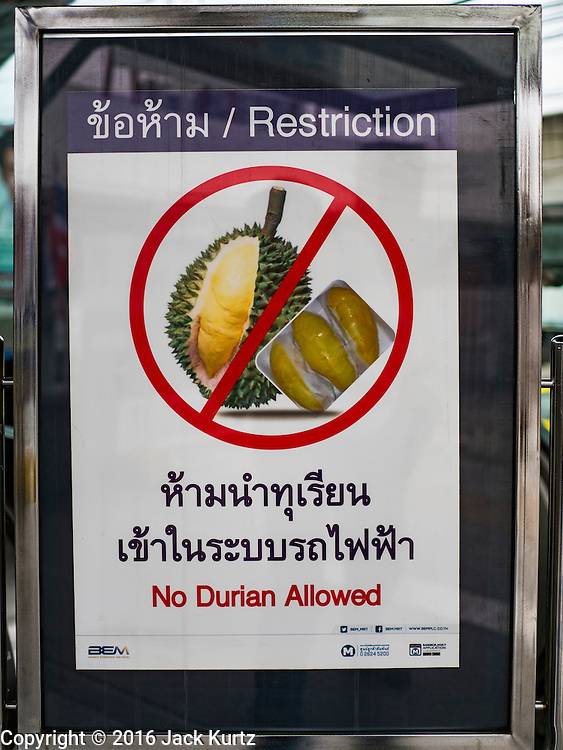 02 JULY 2016 - BANGKOK, THAILAND:  A sign at the entrance to Kamphaeng Phet MRT Station banning durian from the station. Durian is frequently banned from hotels and public transportation in Thailand because of its strong smell.     PHOTO BY JACK KURTZ