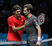 Switzerland's Roger Federer consoles Great Britain's Andy Murray during the Roger Federer vs Andy Murray match at the Barclays ATP World Tour Finals, O2 Arena, London, United Kingdom on 13th November 2014 © Phil Duncan | Pro Sports Images
