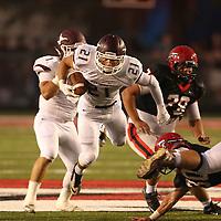 Adam Robison | BUY AT PHOTOS.DJOURNAL.COM<br /> Kossuth's Hunter Brooks leaps through the air as he runs the ball against Corinth Friday night.