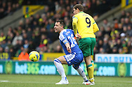 Picture by Paul Chesterton/Focus Images Ltd.  07904 640267.21/01/12.Grant Holt of Norwich and John Terry of Chelsea in action during the Barclays Premier League match at Carrow Road Stadium, Norwich.