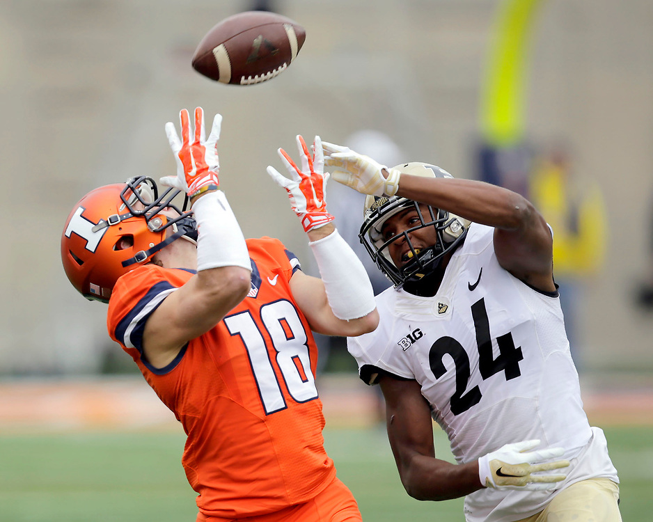 Illinois wide receiver Mike Dudek (18) pulls in a pass under pressure from Purdue defensive back Frankie Williams (24) during the first half of an NCAA college football game at Memorial Stadium Saturday, Oct. 4, 2014, on the University of Illinois campus in Champaign, Ill. (Lee News Service/ Stephen Haas)