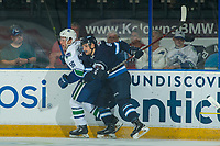 PENTICTON, CANADA - SEPTEMBER 8: Guillaume Brisebois #56 of Vancouver Canucks is checked by Cristiano DaGiacinto #87 of Winnipeg Jets on September 8, 2017 at the South Okanagan Event Centre in Penticton, British Columbia, Canada.  (Photo by Marissa Baecker/Shoot the Breeze)  *** Local Caption ***