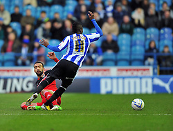 Bristol City Captain, Liam Fontaine tackles Sheffield Wednesday's Jermaine Johnson - Photo mandatory by-line: Joe Meredith/JMP  - Tel: Mobile:07966 386802 08/12/2012 - Sheffield Wednesday v Bristol city - SPORT - FOOTBALL - Championship -  Sheffield - Hillsborough -