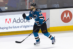 Jan 17, 2012; San Jose, CA, USA; San Jose Sharks defenseman Brent Burns (88) celebrates after scoring a goal against the Calgary Flames during shootouts at HP Pavilion. San Jose defeated Calgary 2-1 in shootouts. Mandatory Credit: Jason O. Watson-US PRESSWIRE