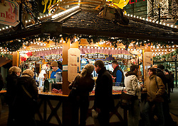 Traditional outdoor Gluhwein bar at night in Christmas market in central Berlin Germany