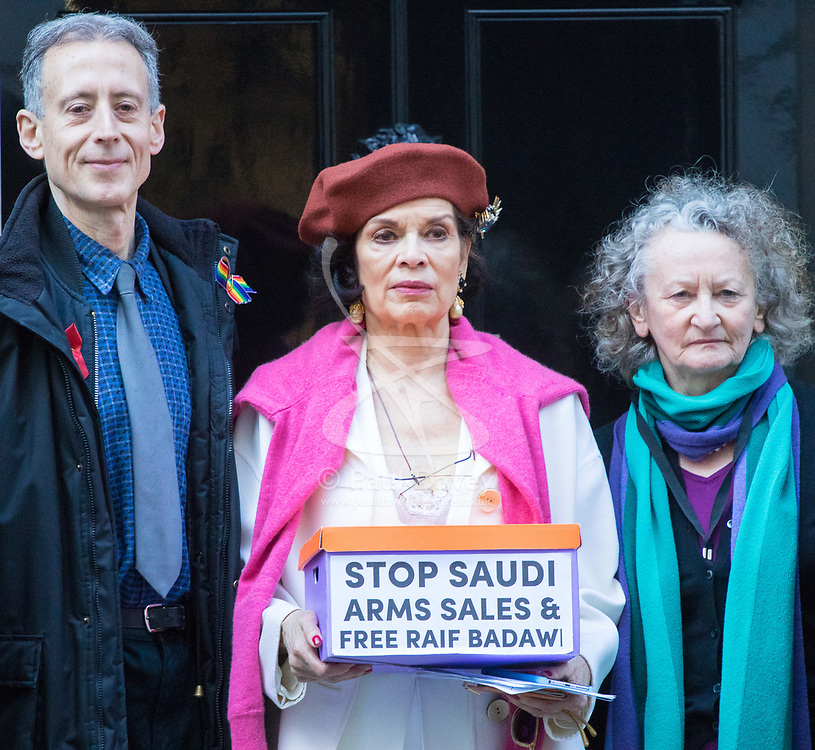 Downing Street, London, March 15th 2017. Bianca Jagger joins Bianca Jagger will join Peter Tatchell and others to hand in a 159,000-signature petition that urges the UK government to halt arms sales to Saudi Arabia over its war crimes in Yemen and its jailing of blogger Raif Badawi and other political prisoners, to Prime Minister Theresa May at 10 Downing Street. PICTURED: Peter Tatchell, Bianca Jagger, Jenny Jones