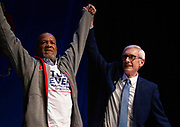Tony Evers celebrates with [MANDELA BARNES FATHER?] during the Election Night watch party at the Orpheum Theater in Madison, Wisconsin, Wednesday, Nov. 7, 2018.
