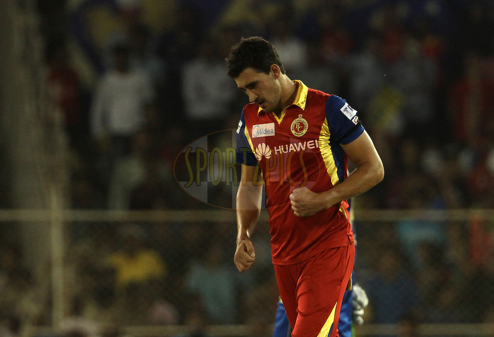 Royal Challengers Bangalore player Mitchell Starc celebrates the wicket of Rajasthan Royals player Stuart Binny during match 22 of the Pepsi IPL 2015 (Indian Premier League) between The Rajasthan Royals and The Royal Challengers Bangalore held at the Sardar Patel Stadium in Ahmedabad , India on the 24th April 2015.<br /> <br /> Photo by:  Vipin Pawar / SPORTZPICS / IPL