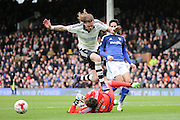 Fulham defender, Richard Stearman (05) hurdling Fulham goalkeeper, Marcus Bettinelli (01) during the Sky Bet Championship match between Fulham and Cardiff City at Craven Cottage, London, England on 9 April 2016. Photo by Matthew Redman.