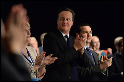 The Prime Minister David Cameron applauds Lady Thatcher after watching a tribute video to the late Lady Thatcher at the opening of the Conservative Party Conference. Manchester, United Kingdom. Sunday, 29th September 2013. Picture by Andrew Parsons / i-Images