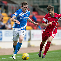 St Johnstone v Stirling Albion…30.07.16  McDiarmid Park. Betfred Cup<br />Blair Alston is closed down by Darren Smith<br />Picture by Graeme Hart.<br />Copyright Perthshire Picture Agency<br />Tel: 01738 623350  Mobile: 07990 594431