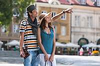 Young man showing something to woman during vacation