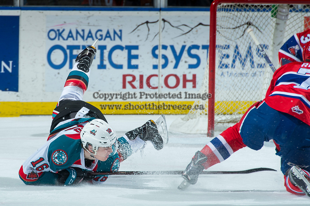 KELOWNA, CANADA - MARCH 3:  Kole Lind #16 of the Kelowna Rockets falls to the ice during first period against the Spokane Chiefs on March 3, 2018 at Prospera Place in Kelowna, British Columbia, Canada.  (Photo by Marissa Baecker/Shoot the Breeze)  *** Local Caption ***