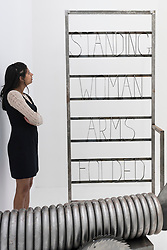 "© Licensed to London News Pictures. 22/06/2016. London, UK. A staff member looks at ""Q Love Stand In"" by Kira Freije at the annual exhibition of works by artists graduating from the UK's longest established art school, RA Schools Show, at the Royal Academy in Piccadilly.  Works from 17 emerging artists are on show 23 June to 3 July. Photo credit : Stephen Chung/LNP"