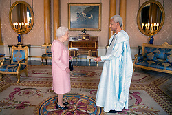 Sem Amine Abba Sidick, Ambassador of Chad, presents his credentials to Queen Elizabeth II during a private audience at Buckingham Palace, London.