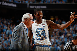 CHAPEL HILL, NC - FEBRUARY 09: Kenny Williams #24 of the North Carolina Tar Heels talks to head coach Roy Williams of the North Carolina Tar Heels during a game against the Miami Hurricanes on February 09, 2019 at the Dean Smith Center in Chapel Hill, North Carolina. North Carolina won 85-88 in OT. (Photo by Peyton Williams/UNC/Getty Images) *** Local Caption *** Kenny Williams;Roy Williams