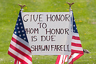 Stone Ridge, New York  - Signs and American flags line Route 209, where people gathered to honor U.S. Army Sgt. Shawn M. Farrell II on May 7, 2014. Farrell died April 28 when forces attacked his unit with small arms fire in Afghanistan.