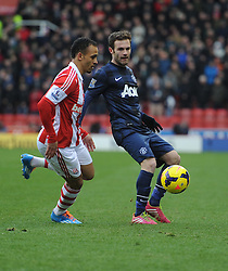 Stoke City's Peter Odemwingie tries to tackle Manchester United's Juan Mata - Photo mandatory by-line: Alex James/JMP - Tel: Mobile: 07966 386802 01/02/2014 - SPORT - FOOTBALL - Britannia Stadium - Stoke-On-Trent - Stoke v Manchester United - Barclays Premier League