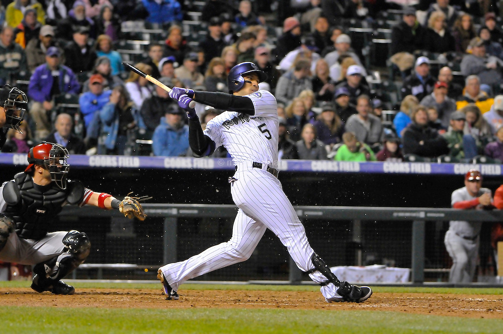 Carlos Gonzalez of the Colorado Rockies shatters his bat in a game against the Arizona Diamondbacks