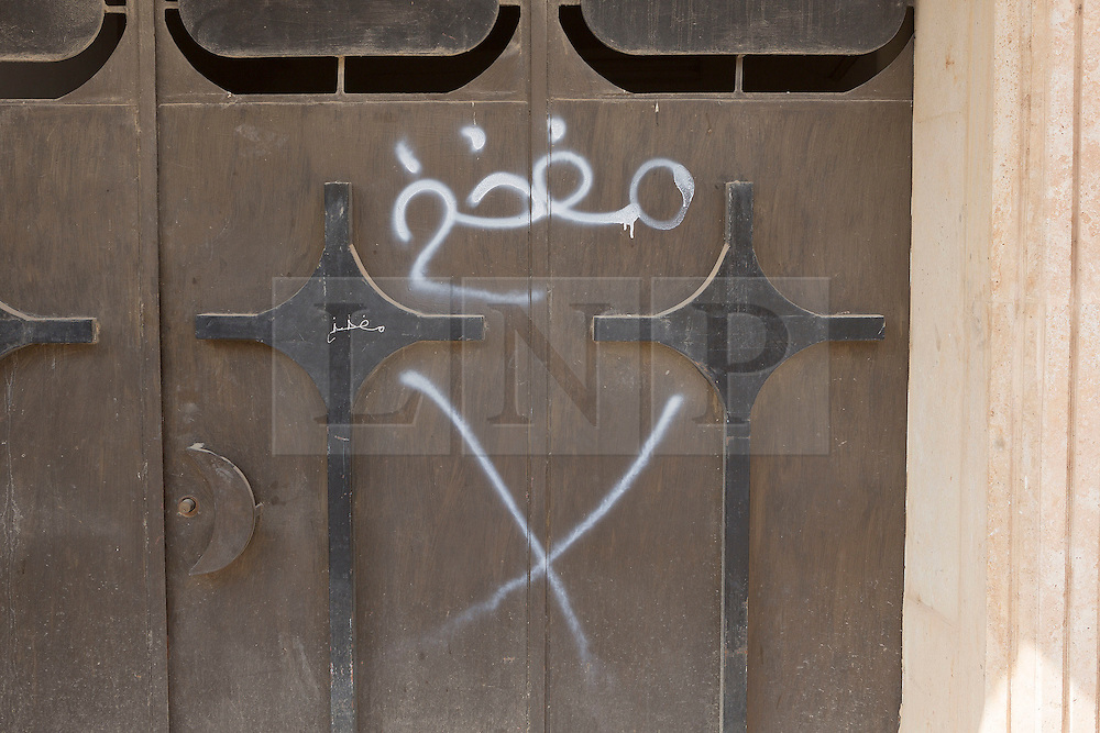Licensed to London News Pictures. 23/10/2016. Markings denoting that a building contains improvised explosive devices are seen on the door of a former ISIS headquarters in the town of Bartella, Iraq.<br /> <br /> Bartella, a mainly Christian town with a population of around 30,000 people before being taken by the Islamic State in August 2014, was captured two days ago by the Iraqi Army's Counter Terrorism force as part of the ongoing offensive to retake Mosul. Although ISIS militants were pushed back a large amount of improvised explosive devices are still being found in the town's buildings. Photo credit: Matt Cetti-Roberts/LNP