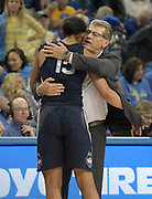 Connecticut Huskies head coach Geno Auriemma and forward Gabby Williams (15) embrace during an NCAA women's basketball game against the UCLA Bruins  in Los Angeles on Tuesday, Nov. 21, 2017. UConn defeated UCLA 78-60.