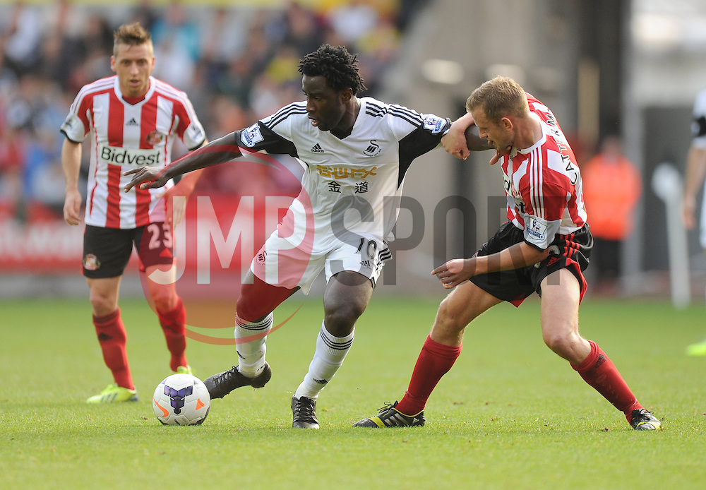 Swansea City's Wilfried Bony shields the ball from Sunderland's Lee Cattermole - Photo mandatory by-line: Alex James/JMP - Tel: Mobile: 07966 386802 19/10/2013 - SPORT - FOOTBALL - Liberty Stadium - Swansea - Swansea City v Sunderland - Barclays Premier League