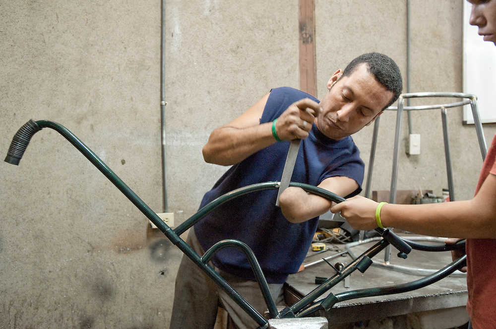 Alejandro Zelaya works on a wheelchair at the PLUSAA workshop in León, Nicaragua.
