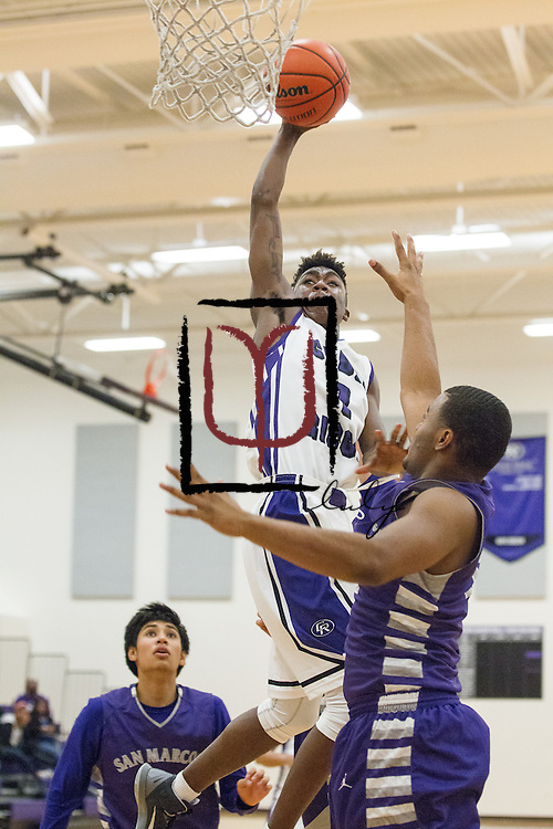 Cedar Ridge's Cameron Mack attempts a basket against San Marcos Friday at home. The Raiders beat the Rattlers 88-87.  (LOURDES M SHOAF for Round Rock Leader.)