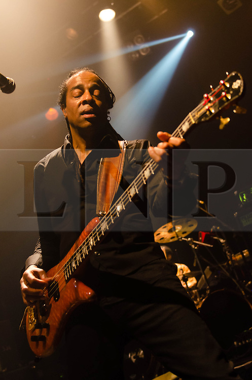 """© Licensed to London News Pictures. 08/03/2013. London, UK.  Doug Wimbish of  Living Colour performing live at KOKO at the band's only UK date on their tour celebrating the 25th Year Anniversary for their debut album Vivid.  In 1990 they won a Grammy Award for Best Hard Rock Performance for their song """"Cult of Personality"""", which featured on """"Vivid"""".  The band formed in New York City in 1984 and consist of Vernon Reid (guitar), Corey Glover (vocals), Will Calhoun (drums) , and Doug Wimbish (bass).  Photo credit : Richard Isaac/LNP"""